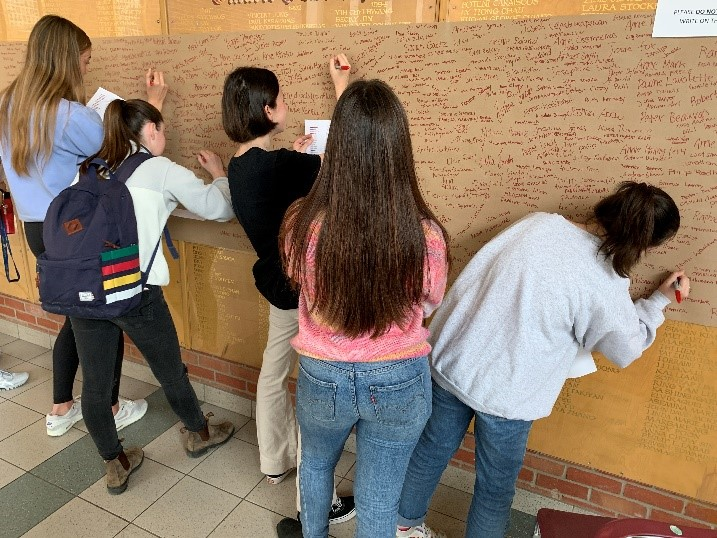 Reconciliation in action: As part of the Legacy Schools program, students at Riverdale Collegiate Institute write out the names of Indigenous children who died in residential schools.