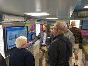 Erik Kremer, Section Manager of Safety Assessment (centre) takes community members from Huron-Kinloss through the NWMO's New Mobile Learn More Centre that was debuted at the 2nd Huron-Kinloss Nuclear Waste Symposium in late August.