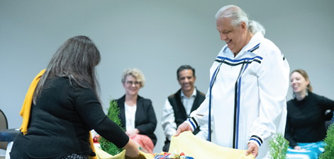 The NWMO's Jessica Perritt, Section Manager for Indigenous Knowledge and Reconciliation, and Bob Watts, Vice-President of Indigenous Relations, gather the sacred bundle at the ceremony formalizing the NWMO's Reconciliation Policy.