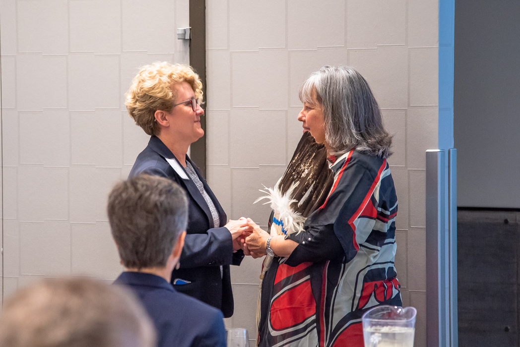 NWMO President and CEO Laurie Swami (left) and Elder Diane Longboat (right) greet each other at the NWMO's 17th annual Geoscience Seminar.