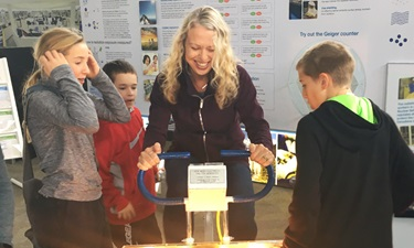 This photo shows a picture of South Bruce students exploring the Bruce Power Visitor Centre.