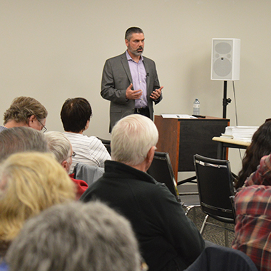This image shows Derek Wilson presenting his update to members of the Elliot Lake Community Liaison Committee.