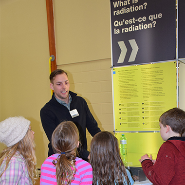 This image depicts local school children learning about radiation at the recent Huron-Kinloss open house.