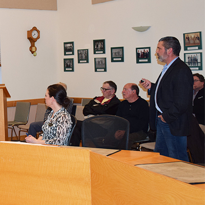 This image shows Derek Wilson presenting his update to members of the Huron-Kinloss Nuclear Waste Community Advisory Committee.