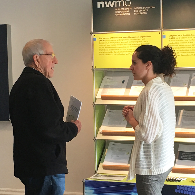 This picture shows a Central Huron man discussing Canada's plan for the safe, long-term management of used nuclear fuel with an NWMO staff member at an open house in Clinton.