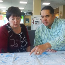 This image shows two people looking at a map.