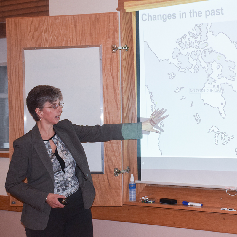 The photo shows NWMO geoscientist Monique Hobbs doing a presentation on the Greenland Analogue Project at a meeting of the Huron-Kinloss Nuclear Waste Community Advisory Committee.