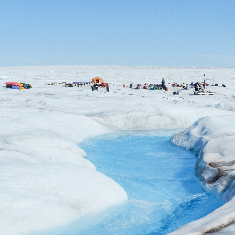 The photo shows a group of researchers'' tents on the Greenland Ice Sheet.