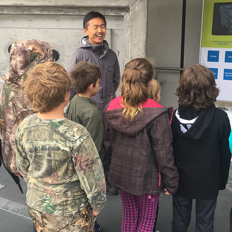Yang Sui, NWMO Mechanical Engineer, talking with elementary school students.