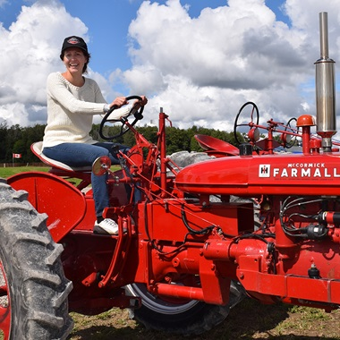 This photo shows a NWMO employee sitting on a tractor at the 2017 International Plowing Match site in Walton, Ontario.
