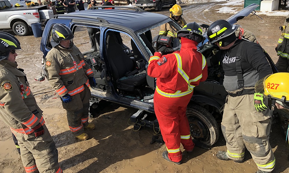 This photo shows a picture of a mock auto extrication at the Bruce County Fire School.