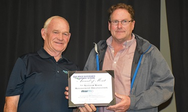 This photo shows Don Farrell from the Pine River Watershed Initiative Network and Paul Austin from the Nuclear Waste Management Organization.