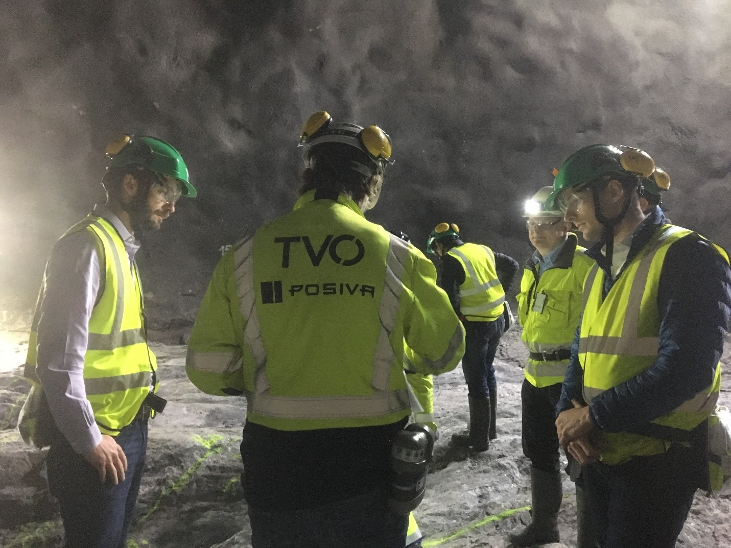 Chris Boyle (left), NWMO Director of Engineering, and Mark Gobien (right), Safety Assessment Models Section Manager, tour the Posiva project in Finland, along with Arto Laikari, a senior scientist involved with the project.