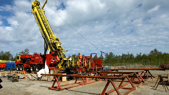 Rotary diamond drill rig and drilling rods.