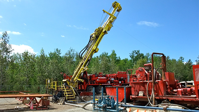 Rotary diamond drill rig and auxiliary pumping equipment.
