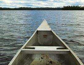 This is an image of a canoe out on the water. It may be necessary to view some features from canoe or boat.