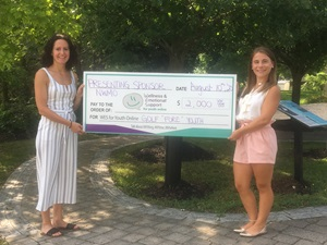 NWMO employee presenting WES for Youth a cheque